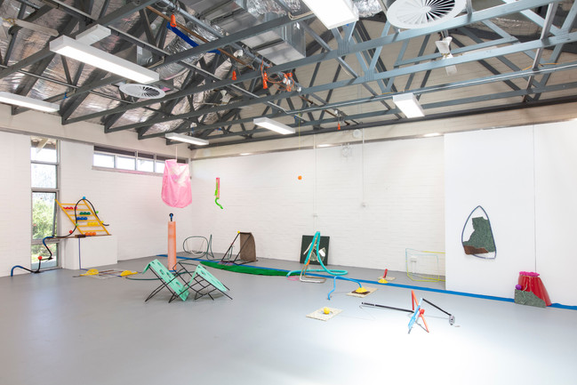 Megan Shaw,  Miscellaneous Goods (installation view) 2018. Discarded objects, paint and industrial materials, dimensions variable. Curtin Graduation Show, Curtin University, Western Australia. Photo credit Bo Wong