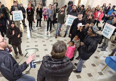 Ashley speaking at Duluth City Hall
