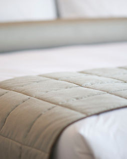close-up-gray-blanket-bed_1122-1470.jpg
