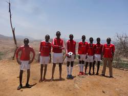 Foot ball unform given to milgis school kids
