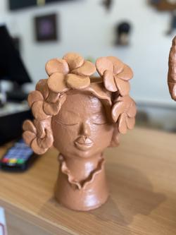 Terracotta lady planter hb
