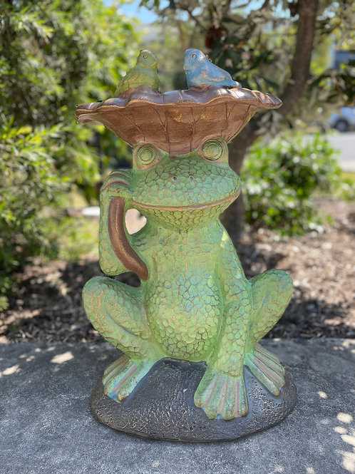 Terracotta frog bird bath
