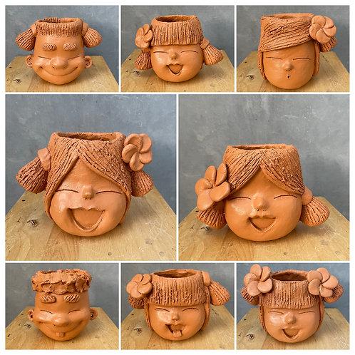 Terracotta head planter