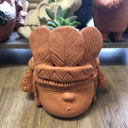 Terracottra head planter