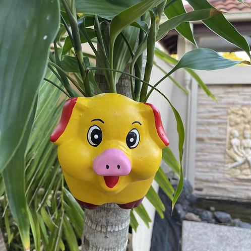 Wall hung ceramic pig vase