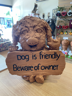 Terracotta sign dog