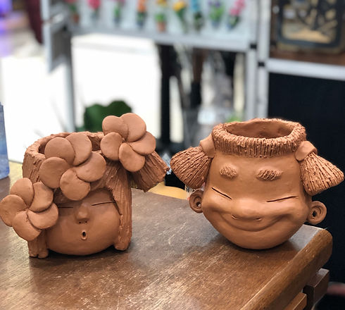 Terracotta boy - girl head planter