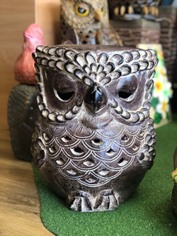 Terracotta owl seat brown