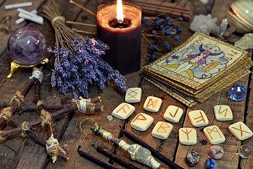 Tarot cards, ancient runes, black candle