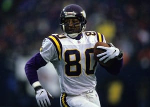 Minnesota Vikings wide receiver Chris Carter (80) runs with the football after making a catch during the Vikings 23-22 victory over the New York Giants in the 1997 NFC Wild Card Playoff Game on December 27, 1997 at Giants Stadium in East Rutherford, New Jersey. (Photo by Allen Kee/Getty Images)