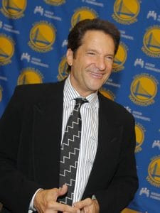 OAKLAND, CA - SEPTEMBER 27: Minority owner Peter Guber of the Golden State Warriors speaks to the media at a press conference to introduce Rick Welts as the new President and Chief Operating Officer of the Golden State Warriors on September 27, 2011 in Oakland, California. NOTE TO USER: User expressly acknowledges and agrees that, by downloading and/or using this Photograph, User is consenting to the terms and conditions of the Getty Images License Agreement. Mandatory copyright notice: Copyright NBAE 2011 (Photo by Rocky Widner/NBAE via Getty Images)