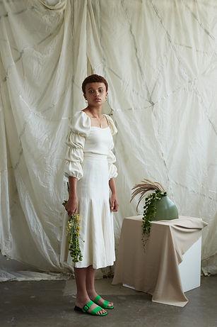 Model holding flowers. Fashion editorial featuring local Melbourne designer Arnsdorf