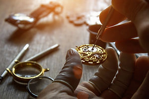 The watchmaker is repairing the mechanical watches in his workshop.jpg