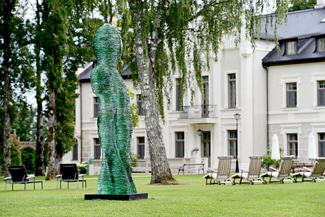 Pullulare stacked glass monumental sculpture at Rumene Manor, by Ernest Vitin