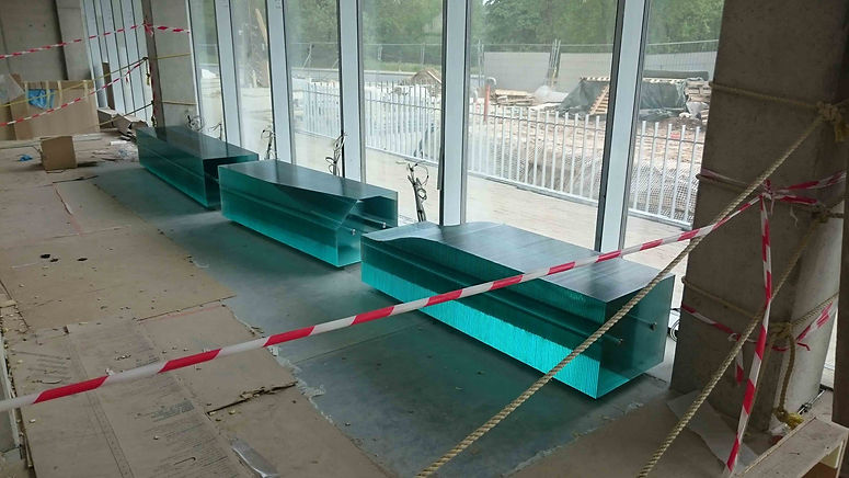 Layered Glass Benches at the construction site- New Academic Center for Natural Sciences of the University of Latvia, by Ernest Vitin