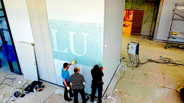 Installing glass signboard by Ernest Vitin