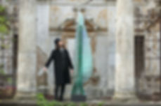 Artist Ernest Vitin at layered glass sculpture Post Procella
