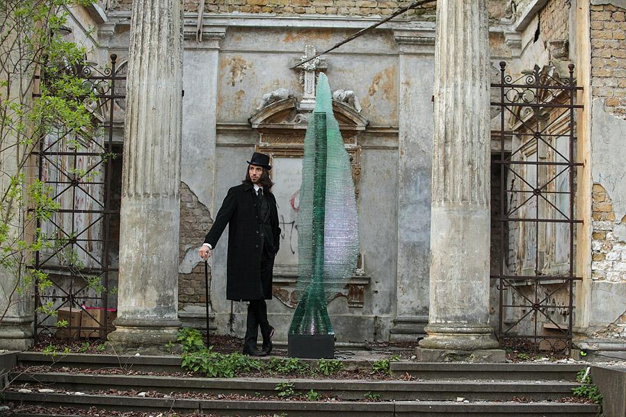 Artist Ernest Vitin by the sculpture