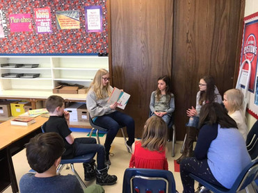 8th grade reading to younger students.jp
