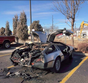 Funny pictures Delorean car with doors up and back half burned up