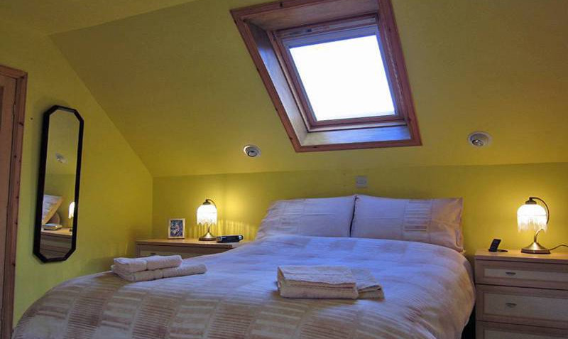 The first floor bedroom features a standard-size double bed