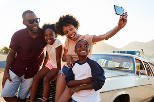 Family Posing For Selfie Next To Car Pac
