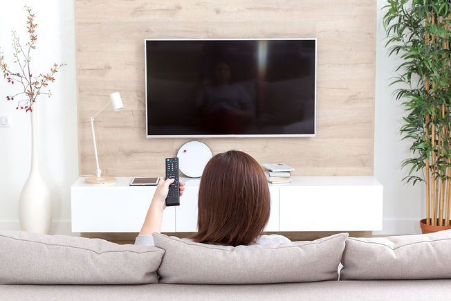 Young woman watching TV in the room.jpg