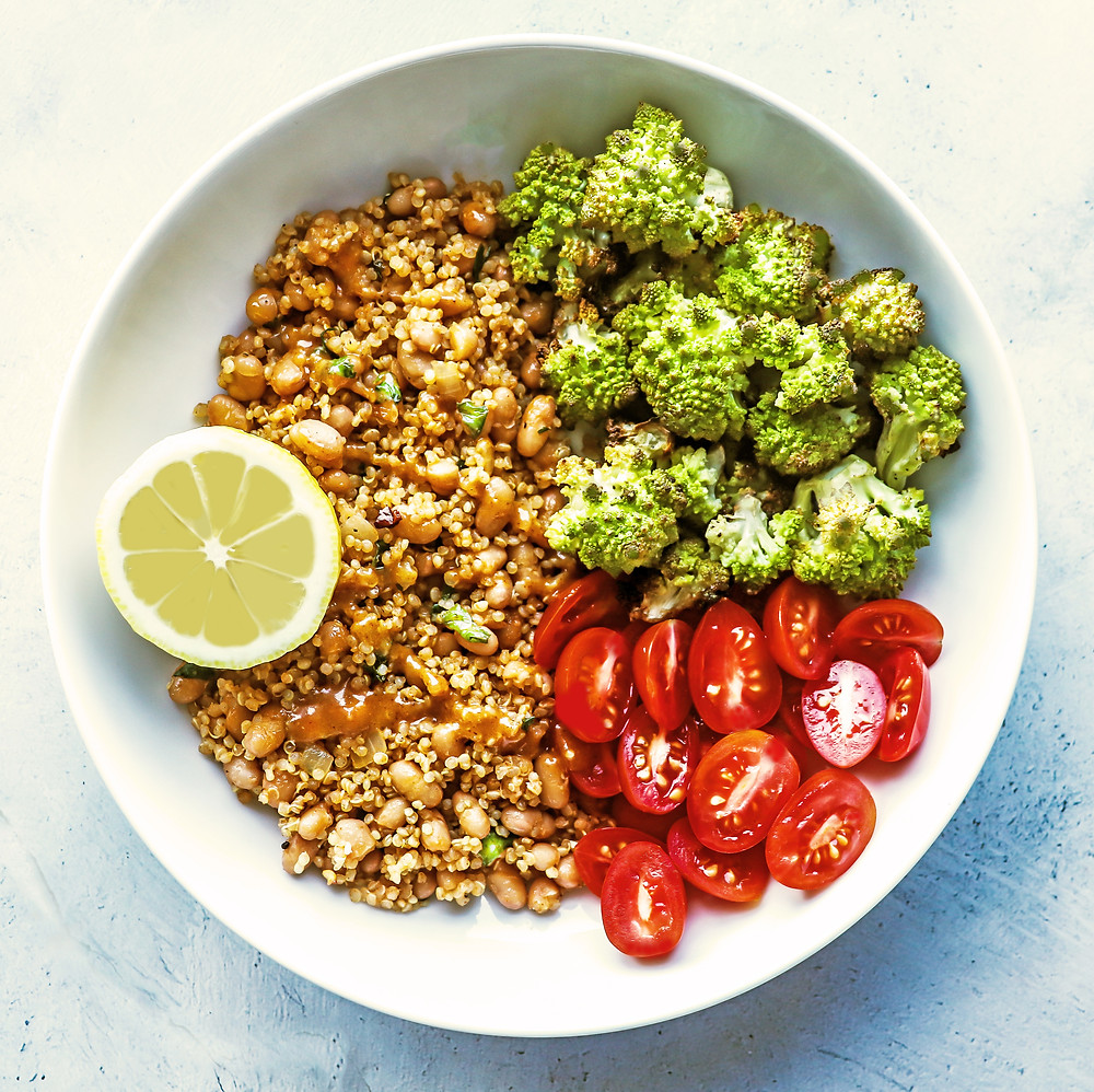 Roasted romanesco bowl with spicy peanut dressing