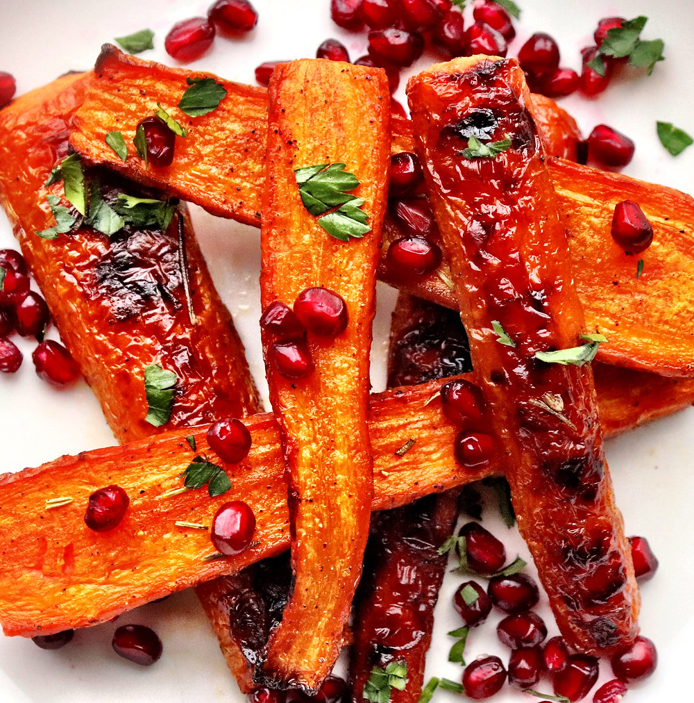 Roasted garlic-rosemary carrots topped with pomegranate