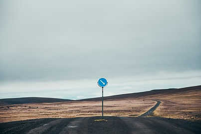dark-dirt-road-with-sign.jpg
