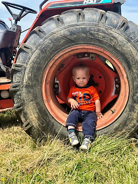 Just a boy and his tractor..jpg