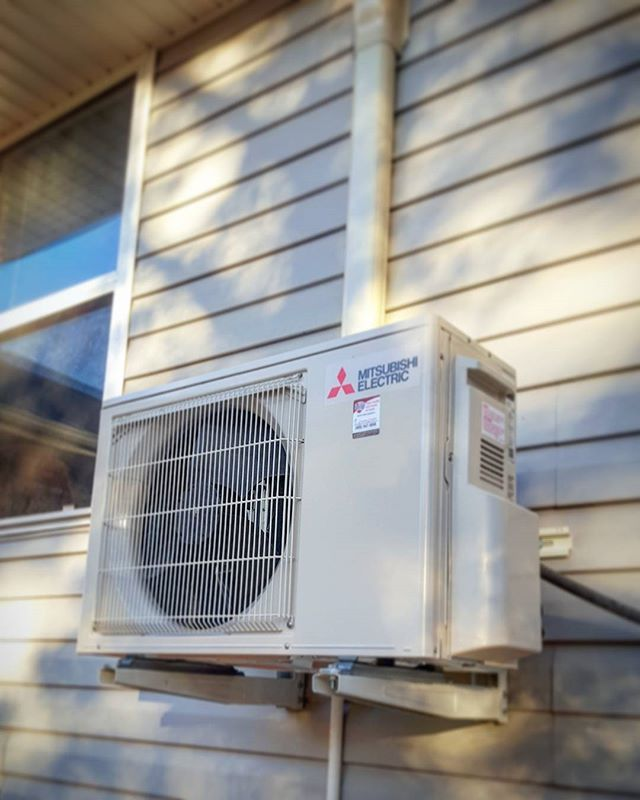 New 15,000 BTU Mitsubishi ductless heat pump mounted on a wall that we just finished. Efficiency rat