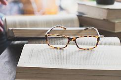 glasses-opening-book-library-cafe-xa.jpg