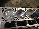 reconditioned engine block with dial indicator on top to check piston patrution