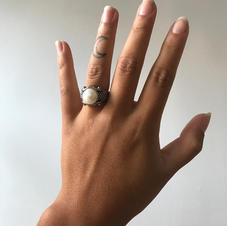 """My ex and I were together for three and a half years and we met when during my sophomore year of high school. He asked me to be his girlfriend on our first date by going on one knee and holding my hand. A few months into dating, I went to Florida for a week and when I came back he told me he had a gift for me. He told me to close my eyes and when he said """"ready"""", I opened my eyes to him kneeling on the ground with this obnoxiously large pearl ring in a box and a huge grin on his face. He wasn't proposing or anything, but he was just playing off of what he did on our first date."""