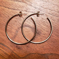 A close friend during college gifted me a pair of gold hoop earrings. They're simple enough to be dressed up or down and served as my introduction into experimenting more with my accessories. Within a few months, we had a falling out and drifted apart. These earrings are the only remnant of our friendship that I've kept to this day.