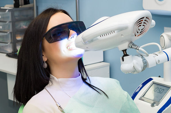 Teeth whitening for woman. Bleaching of