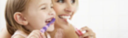Mother And Daughter Brushing Teeth Toget