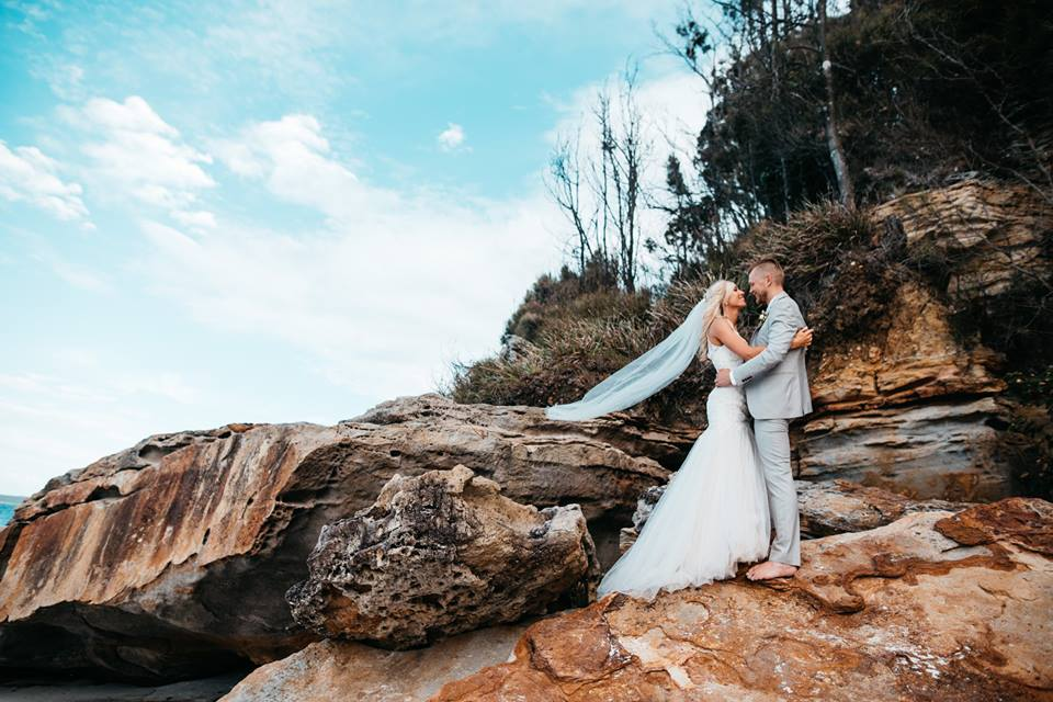 Amelia and Tay Wedding Shot on Rock Clif