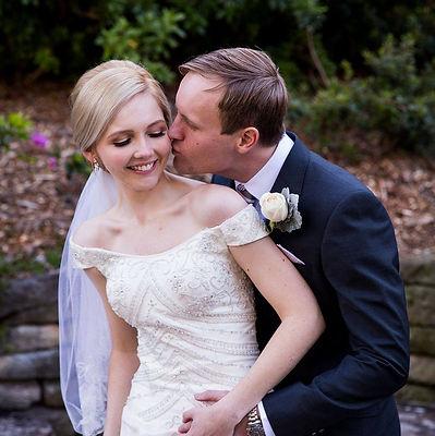 Bride Rachel and her Husband Joshua kissing on their Wedding Day