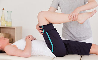 Osteopath working on the right knee