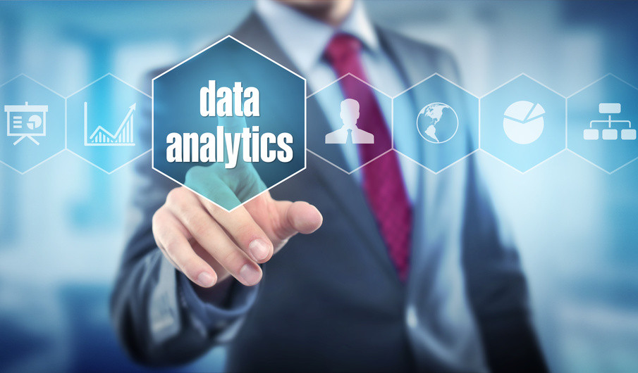 Business man pointing to 'data analytics' graphic