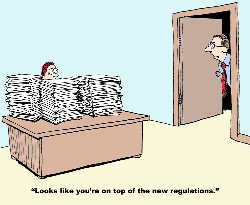 Cartoon image showing man behind many piles of paper and another sating 'Looks like you're on top of the new regulations'