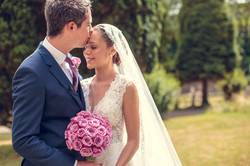 Bride and Groom with matching flowers - pink Cool Water roses