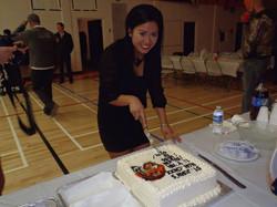 Josephine cutting the Tiger Cake
