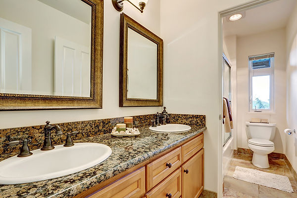 Traditional Bathroom with Black and Brown Mottled Granite Countertop, Natural Finish Cabinets