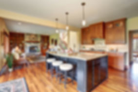 Kitchen, Mahogany Cabinets, Large Black Island with Beige Granite Countertop with Beveled Edge and Curved Shape, Beige Subway Tile