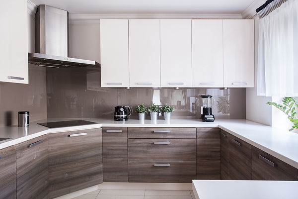 Modern Kitchen, White Sleek Cabinets, Glossy Grey Backsplash, Stainless Steel Range Hood, Smooth Surface Electric Cooktop