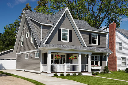 Grey Cottage Style House Renovated, Replacement Windows, White Front Door, Black Shutters