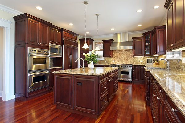 Traditional Kitchen with Dark Mahogany Cabinets, Stainless Steel Appliances, and Beige & Black Mottled Granite